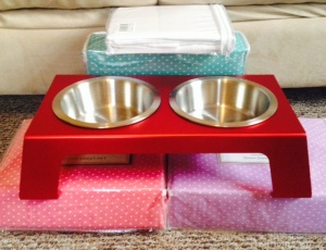 3 pastel polka-dotted sheet sets, one cat food/water bowl system, and a set of white pillowcases for good measure.